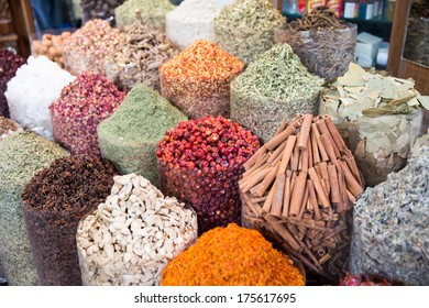 A spice vendor's display at a local market in Dubai: colorful, powdered spices in large sacks