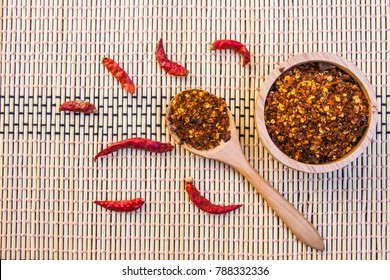Spiced cayenne pepper in wooden bowl. Top view