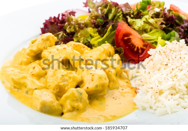 spiced chicken served with fresh salad