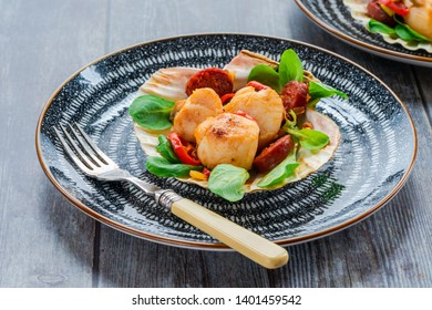 Spiced scallops with chorizo and chili in shell