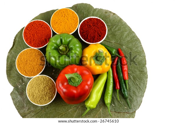 Spices arranged around colorful capsicums