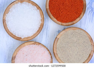 Spices in a bamboo bowls on wooden table
