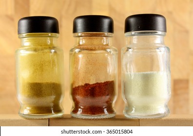 Spices in bottles , spice rack