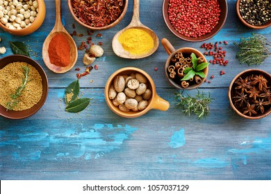 Spices bright blue wooden background. Top view