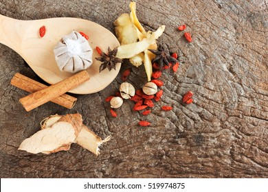 Spices chinese food and herbal wrap for stewed on old wood background