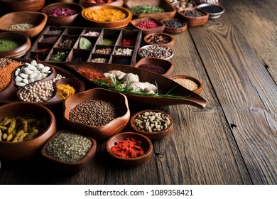 Spices closeup. Rustic wooden table.