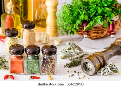 Spices, food seasoning pepper mill and green herbs. paprika, thyme and parsley