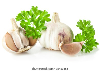 Spices: Garlic and fresh parsley leaves over white background