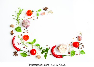 Spices and herbs as a border isolated on white