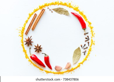 Spices and herbs in the form of a circle with space for text