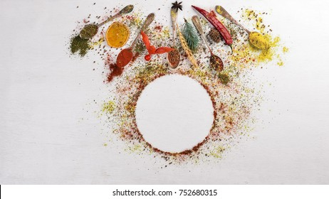Spices and herbs. A large assortment of spices. Indian cuisine. On the wooden table. Top view. Free space for text.