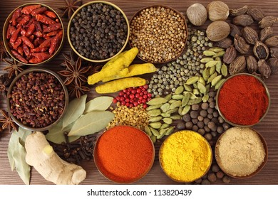 Spices and herbs in metal  bowls. Food and cuisine ingredients. Colorful natural additives.
