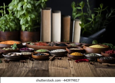Spices and herbs in metal and wooden bowls. Food and cuisine ingredients. Colorful natural additives.