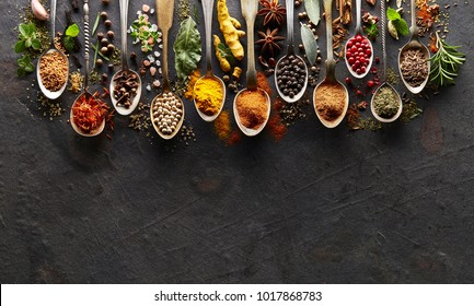 Spices and herbs on  graphite board