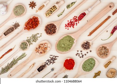 spices and herbs on kitchen wooden table background. food, cooking and restaurant concept. top view, flat lay