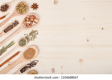 spices and herbs on kitchen wooden table background with copy space for text. food, cooking and restaurant concept. flat lay frame composition, top view