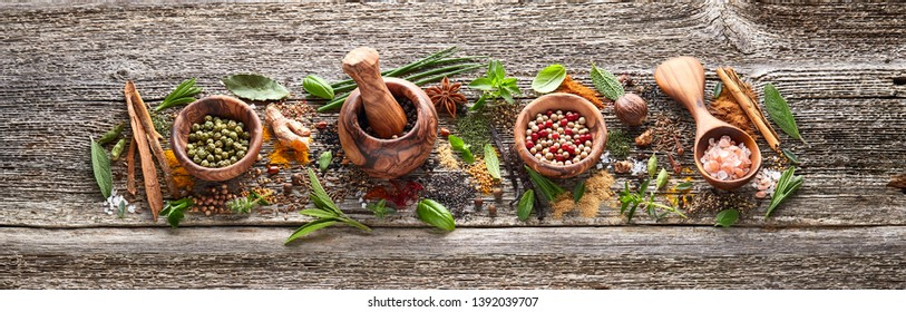 Spices and herbs on old wooden board