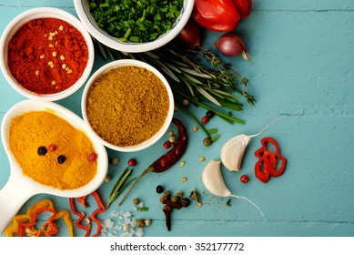 Spices and herbs over blue background.  Food and cuisine ingredients.