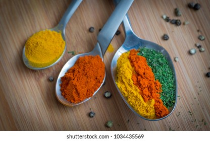 Spices and herbs over wooden background