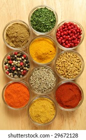 Spices and herbs in small glass bowls. Food and cuisine additives. Colorful natural ingredients.
