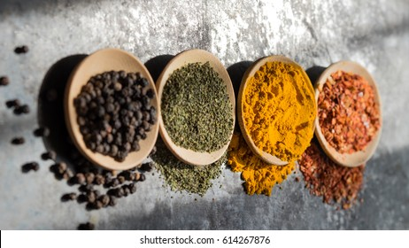 Spices and herbs in a wooden bowl