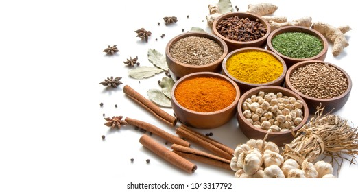 spices and herbs in wooden bowl on white background