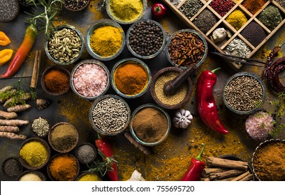 Spices and herbs in wooden bowls. Food and cuisine ingredients
