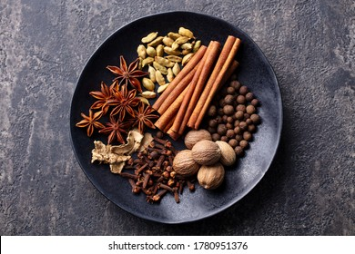 Spices for Indian masala chai. Grey background. Close up. Top view.