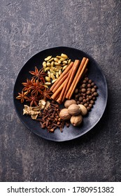 Spices for Indian masala chai. Grey background. Top view.