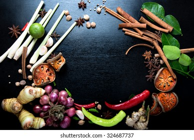 spices with ingredients on dark background. asian food, healthy or cooking concept.