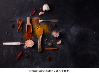 spices on a black background