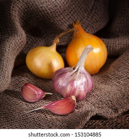 Spices on the cloth on the table. Onions and garlic.