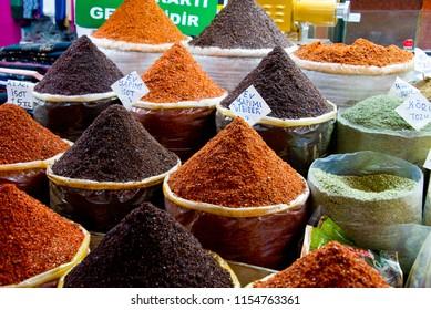 spices on market stall in bazar of sanliurfa, turkey