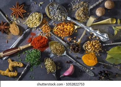 Spices on spoons - a selection of spices used to add flavor to cooking.