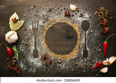 Spices on table with cutlery silhouette, close-up  - Shutterstock ID 230856043