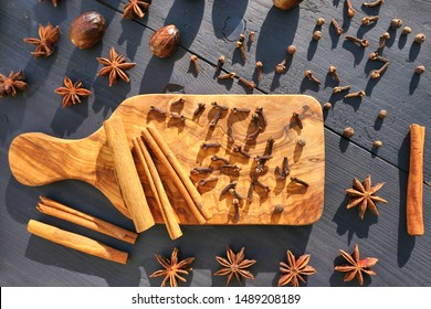 Spices on wooden background. Food ingredients: star anise, cloves, nutmeg and cinnamon sticks, allspice.