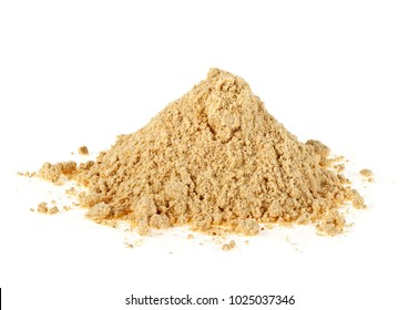 Spices - pile of ginger powder on white background