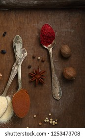 Spices powder on vintage spoons top view