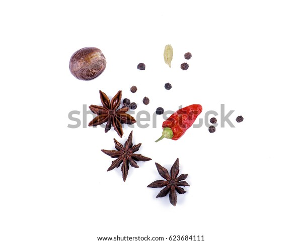 Spices scattered on white background