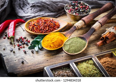 Spices and seasonings on the kitchen table on the old background