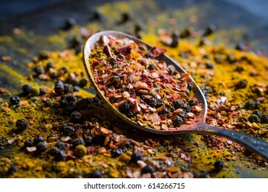 Spices selection over dark wooden background