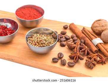 Spices set on wooden board isolated on white.