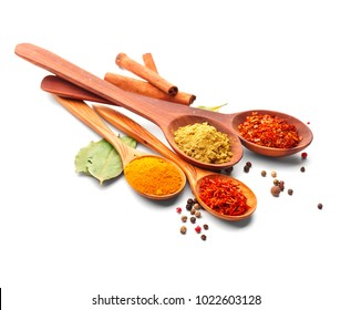 Spices. Spice in Wooden spoon. Herbs. Curry, Saffron, turmeric, cinnamon and other isolated on a white background
