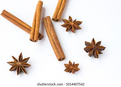 Spices: star anise and cinnamon sticks on white background. Close up