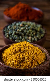 Spices in traditional Asian theme on wooden table