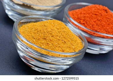 Spices in a transparent bowls on blue background