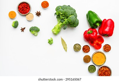 Spices and vegetables for cooking and health on white background with top view and copy space.