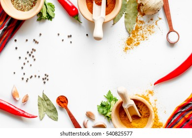 spices in wooden bowl white background top view