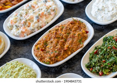 Spicy appetizer. Traditional Turkish and Arabic cuisine meze. Snack meal served alongside the main course. Natural vegetarian food. Bulk appetizer plates. mezeler. appetizer varieties mezzer varieties