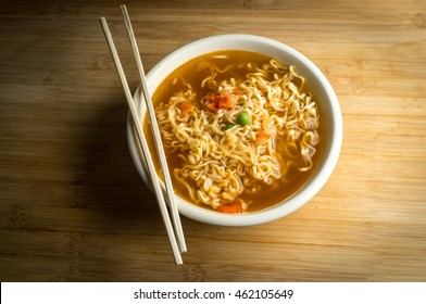 Spicy asian ramen noodle soup with chopsticks